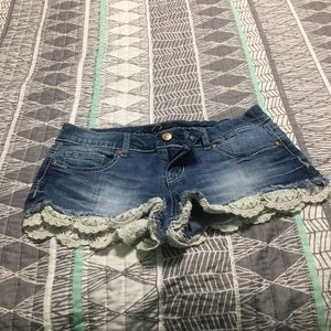 Jean shorts with crochet lace on bottom